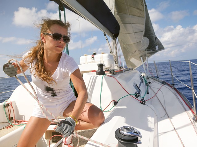 Woman sailing a yacht