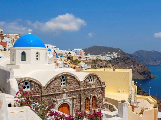 Sun-drenched Santorini awaits visitors to the Greek islands