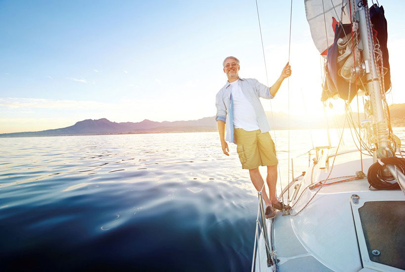 A holidaymaker aboard a charter vessel in an exotic island location